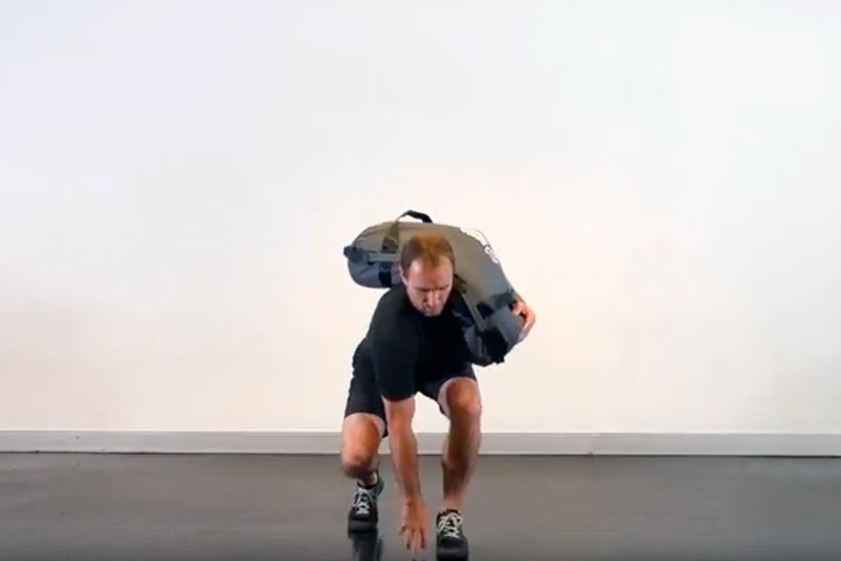 Staggered Stance Rotational Sandbag Squat